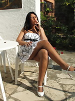 Smoking a cigarette as I'm being naughty in the sun | PantyhoseDiva.com